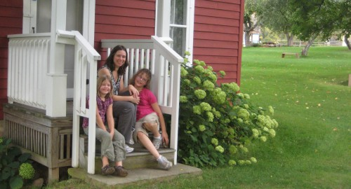 The author and her kids on the front stoop of the Almanzo Wilder Homestead, September 2010